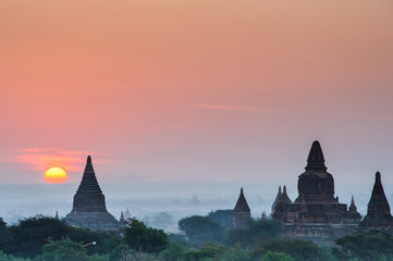 Scenic sunrise above bagan in Myanmar Bagan is an ancient city with thousands of historic Buddhist. Image in silhouette.