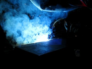 Experienced welder properly holds the lead tip of the welding gun