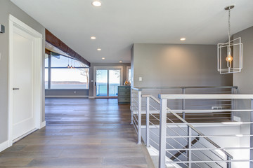 Spacious upstairs landing with gray walls