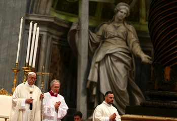 Pope Francis leads a mass to ordain new priests in Saint Peter's Basilica at the Vatican