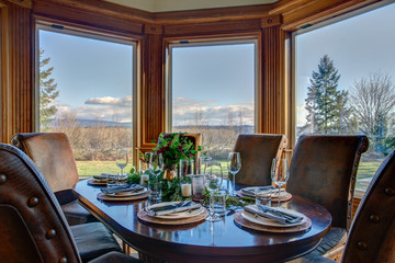 Elegant table set for dinner and beautiful window view.