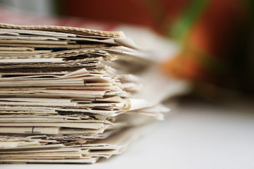 Newspapers stacked in a pile, close up