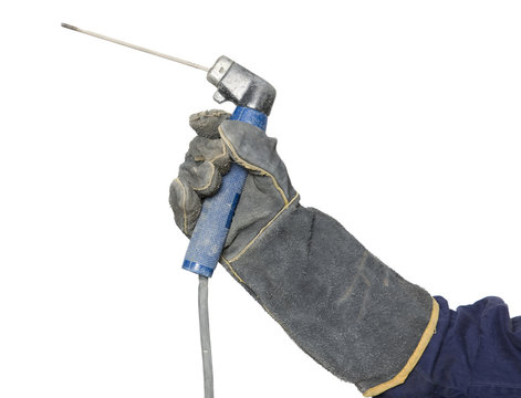 A welding stick in hand and isolated.