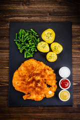 Fried pork chop, potatoes and green beans
