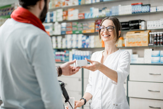 Pharmacist selling medications in the pharmacy store