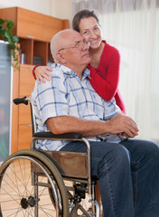 Happy  couple of   woman and   man  in   wheelchair