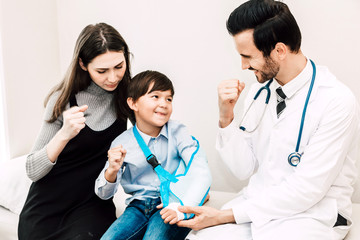 Doctor consulting and check up information with little boy and mom in hospital.A little boy has sick.healthcare and medicine