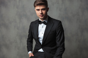 portrait of sexy businessman with hand in pocket dressed formally