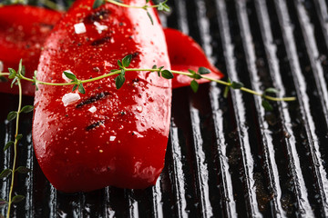 grilled red bell peppers with spices and herbs. Closeup. Copyspace