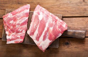 fresh pork ribs on wooden board
