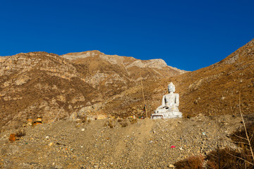 Shakyamuni Buddha stone statue in the temple of Muktinath, Nepal