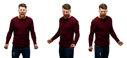 Handsome blond man stressful, terrified in panic, shouting exasperated and frustrated. Unpleasant gesture. Annoying work drives me crazy isolated over white background
