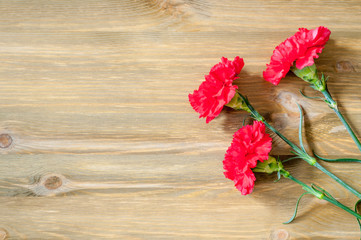9 May background with red carnations on the wooden table