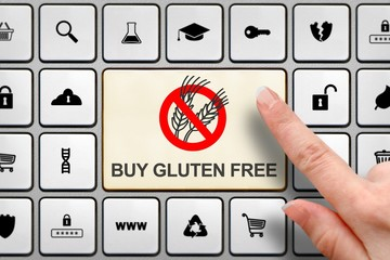 Gluten free diet concept, girl's finger above the big button on the keyboard