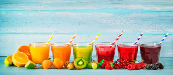 Foto op Plexiglas Sap Various freshly squeezed fruits juices