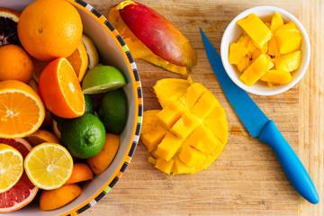 Slicing and preparing fresh healthy tropical fruit