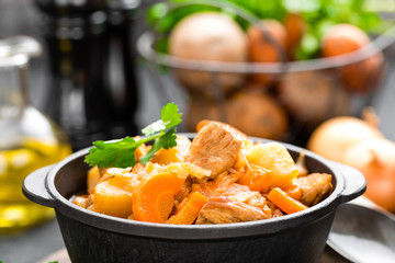 Meat stew with vegetables. Braised meat with cabbage, carrot and potato