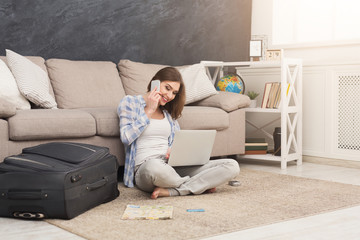 Excited woman planning her annual vacation online