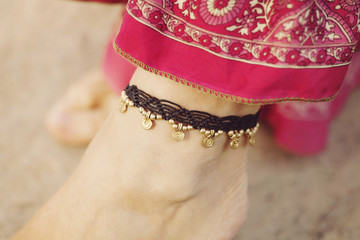 Female ankle with gypsy bracelet
