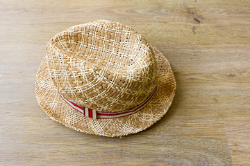 Straw hat against a wood floor background