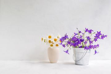 Summer flowers in a metal bucket
