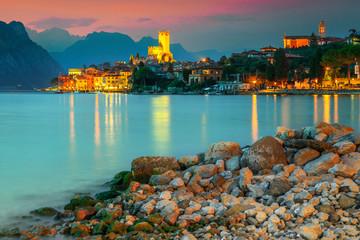 Amazing Malcesine tourist resort and colorful sunset, Garda lake, Italy Wall mural