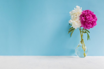 White and pink peonies in a vase