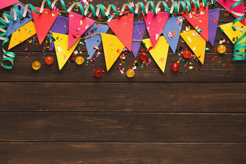 Colorful flags garland on wooden background