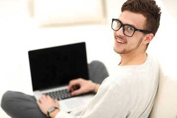 closeup of a modern young man working on laptop