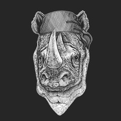 Rhinoceros, rhino Cool pirate, seaman, seawolf, sailor, biker animal for tattoo, t-shirt, emblem, badge, logo, patch. Image with motorcycle bandana