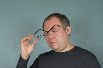 Man Looking Through New Glasses