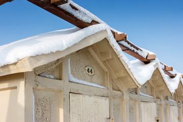 """""""Cabine"""" (Beach huts) covered in snow in Riccione, Emilia Romagna, Italy."""