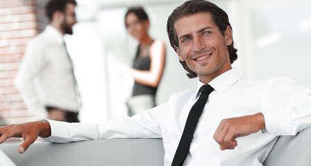 portrait of pensive businessman on blurred background.