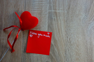 I love you mum text and heart on wooden background, Mother`s Day concept with copy space for design