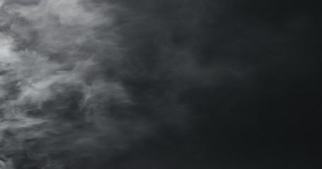 vapor steam over black background