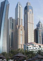 View of Dubai tall buildings from sea front