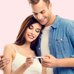 Couple, finding out results of a pregnancy test