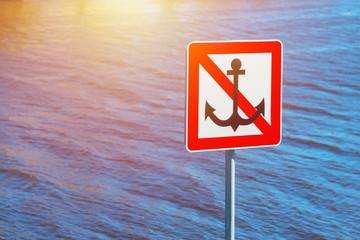 Sign next to water, Anchoring forbidden