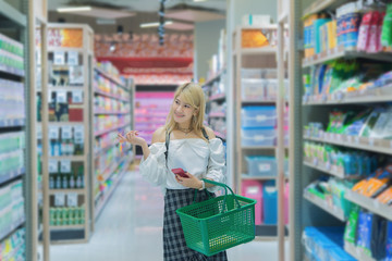 Beautiful asian woman shopping  with shopping bags at department store,Thailand people shop at mall,Lifestyle of modern girl,Happy woman concept