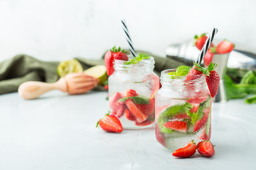Alcohol cocktail mojito lemonade with rum, soda, strawberry and basil