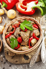 Chicken liver with sweet pepper and tomatoes