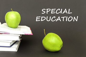text special education, two green apples, open books with concept