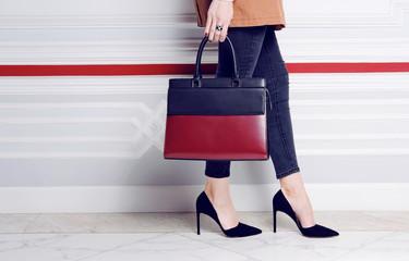Wall Mural - Close up legs fashion woman in heel shoes with big handbag