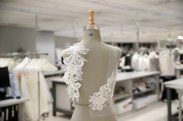 Decorations are fixed on a mannequin at Pronovias Atelier ahead of the Barcelona Bridal Week