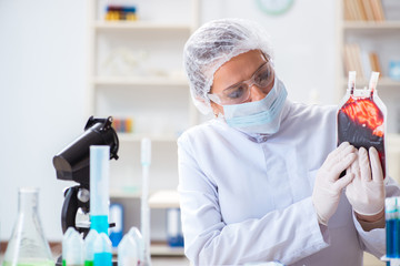 Woman doctor checking blood samples in lab