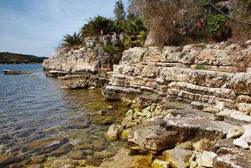 Rocky beach at Kassiopi village in Corfu, Greece