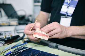 Laboratory dentist technician working on prostetic tooth close