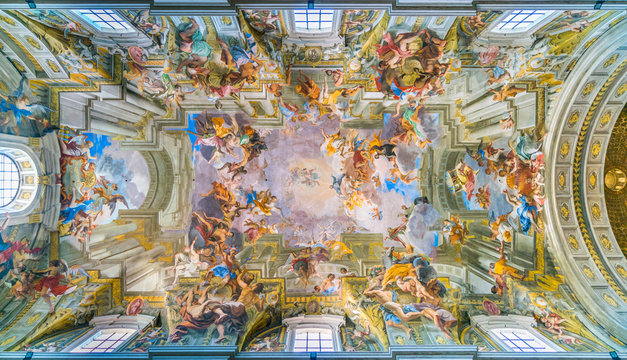 """The painted vault with the """"Apotheosis of Saint Ignatius"""" by Andrea Pozzo, in the Church of Saint Ignatius of Loyola in Rome, Italy."""