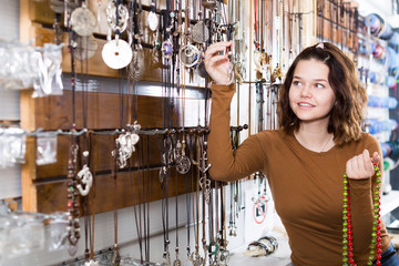 Female offering to buy fashionable necklace