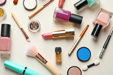 Flat lay composition with decorative cosmetics on color background
